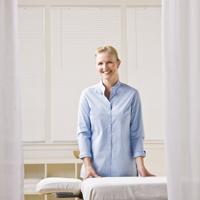 Massage therapist next to massage table